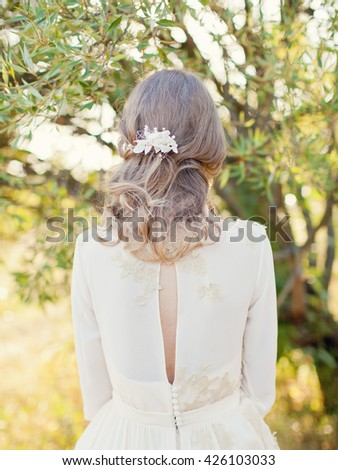 bride in wedding dress from the back - stock photo