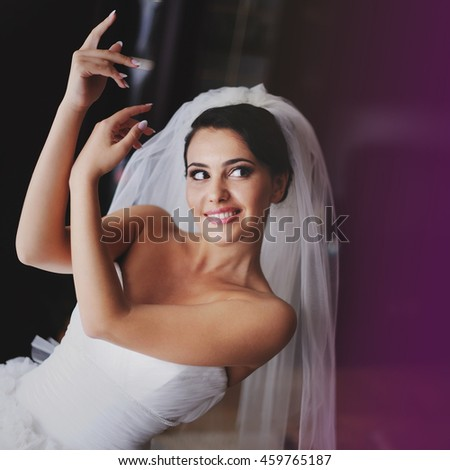 bride in wedding dress getting ready for wedding - stock photo