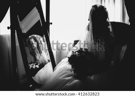 Bride in wedding veil is looking forward to the wedding celebration - stock photo
