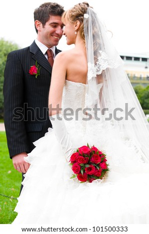 bride is hiding her wedding bouquet from groom - stock photo