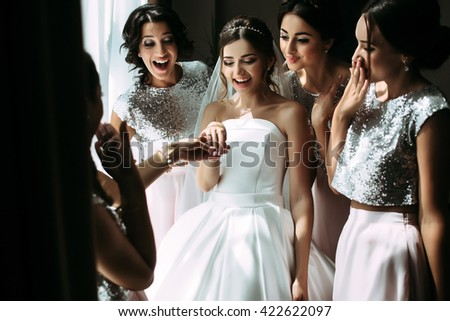 Bride is showing her engagement ring - stock photo