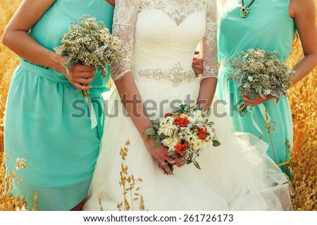 bride-maids and the bride with a bouquet - stock photo