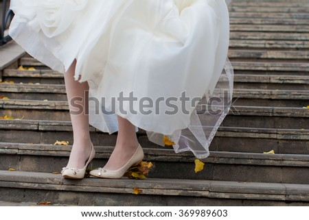 bride on foot with shoes - stock photo