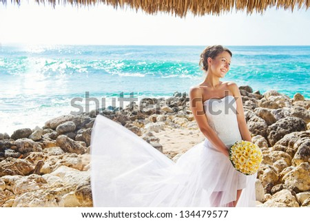 bride on the beach, bali - stock photo
