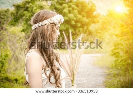 Bride on their wedding day in garden,asian lover - stock photo