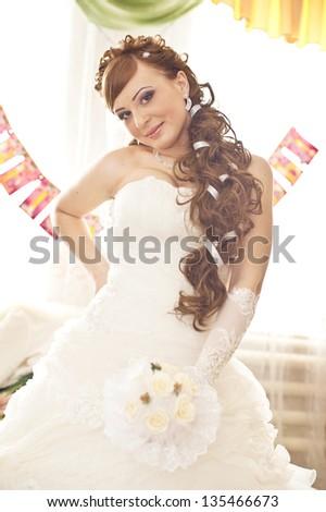 Bride portrait.Wedding dress. Brunet bride portrait with flowers - stock photo