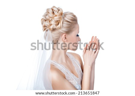 Bride preparing for her wedding hairstyle makes. - stock photo
