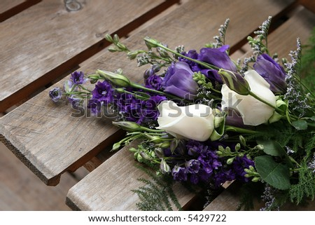 bride's bouquet on wooden seat - stock photo