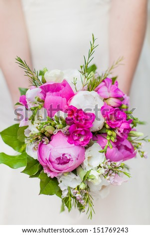 Bride's bouquet with peonies in the hands - stock photo