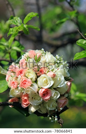 Bride's bouquet with wedding rings - stock photo