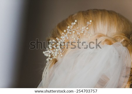 Bride's hair, styled with a hair ornament. Wedding accessories - stock photo