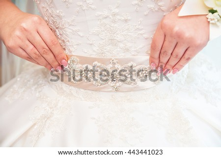bride's hands with wedding rings close up - stock photo