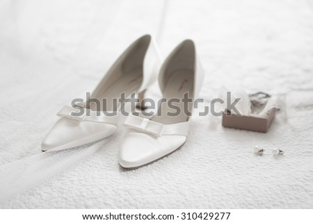 Bride shoes, wedding rings and details - stock photo