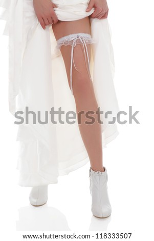 Bride shows her leg, white background - stock photo