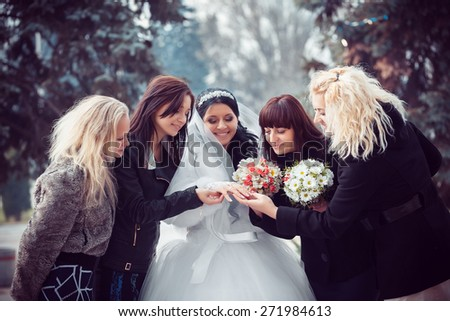 bride shows the wedding ring to bridesmaids - stock photo