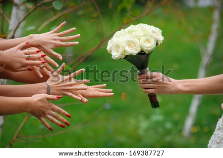 bride stretches a beautiful wedding bouquet - stock photo