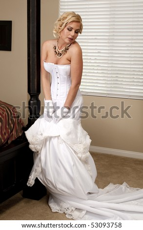 Bride Striptease Series #5 - stock photo