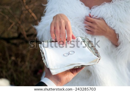 bride takes the ring, fiance proposed - stock photo