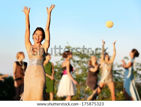 Bride throwing the bridal bouquet - stock photo