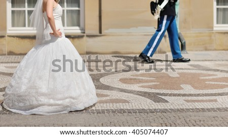 Bride walking next to queen guard in Copenhagen, Denmark - stock photo
