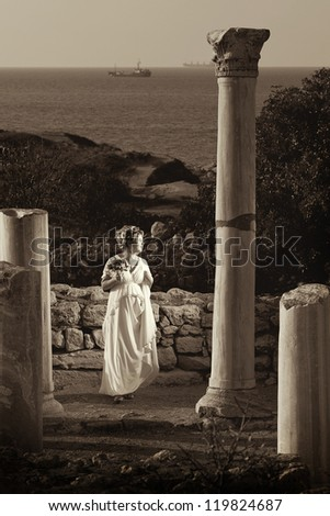 bride with a bouquet of flowers is on the ancient city - stock photo