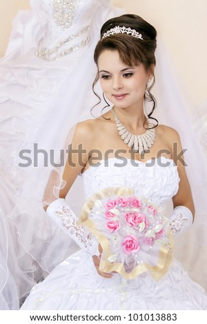 bride  with bouquet in the her hands - stock photo