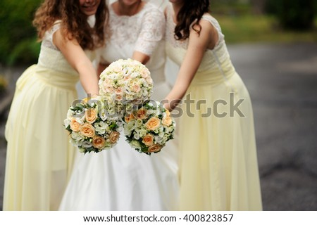 bride with bridesmaid with bouquets - stock photo