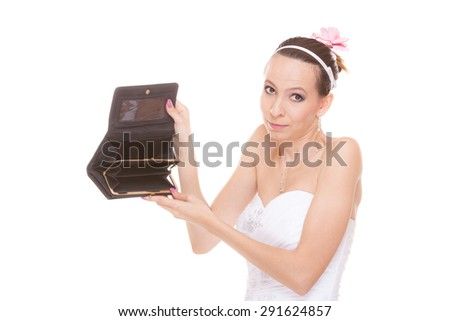 Bride with empty wallet. Young girl holding purse looking for money cash. Wedding expenses costs, expenditure. Finance concept. Woman in white wedding dress isolated on white background. - stock photo