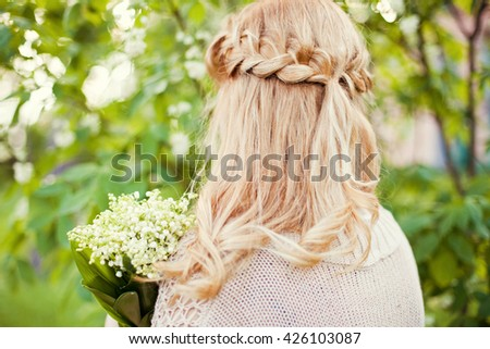 bride with flowers in the forest - stock photo