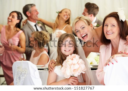 Bride With Grandmother And Bridesmaid At Wedding Reception - stock photo