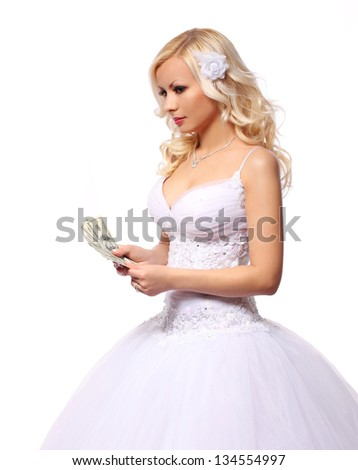 bride with money. holding and counting dollars bills. beautiful blonde young woman isolated on white background. concept - stock photo