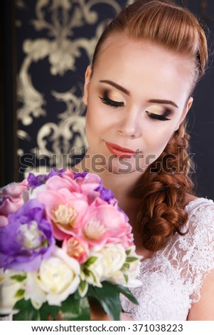 Bride with professional make up, with closed eyes - stock photo