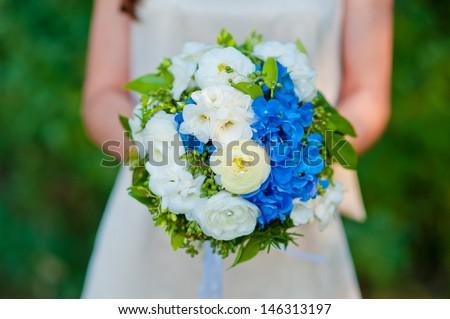 Bride with wedding  bouquet - stock photo