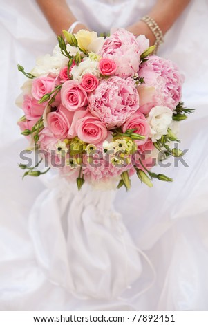 Bride with wedding bouquet, closeup - stock photo