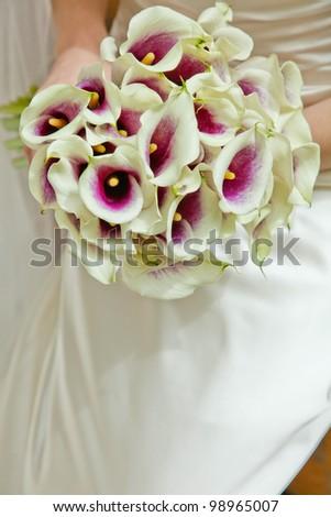Bride with white wedding flowers - stock photo