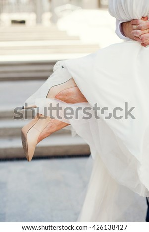 brides legs under wedding dress - stock photo