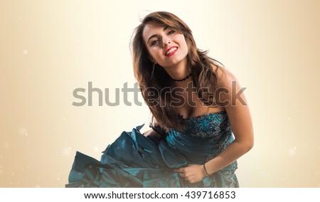 Bridesmaid dancing over ocher background - stock photo