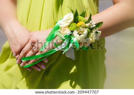 Bridesmaid holding colored wedding bouquet of flowers - stock photo