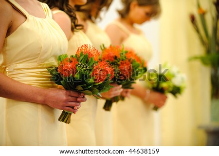 Bridesmaids with bouquets - stock photo