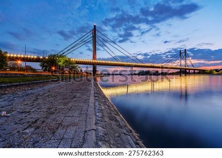 Bridge across river at night with artificial lightning, Belgrade Serbia - stock photo