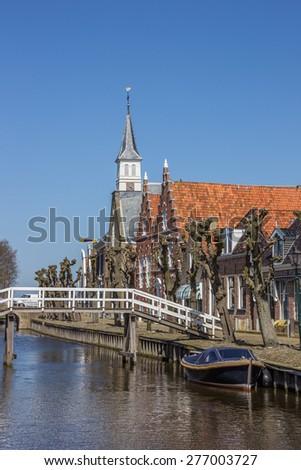 Bridge across the main canal in Sloten, Netherlands - stock photo