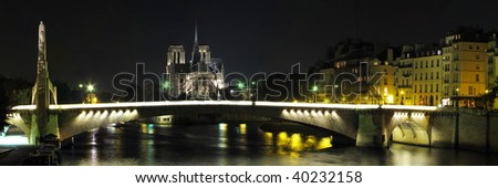 bridge and building at the historical center of Paris by night - stock photo
