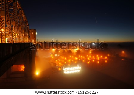 Bridge And Harbor In Heavy Fog At Night  - stock photo