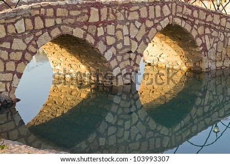bridge and reflection - stock photo