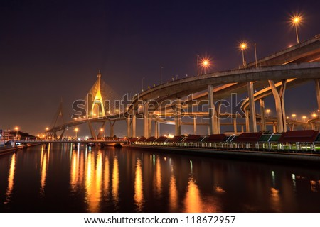 Bridge and skyline at night - stock photo