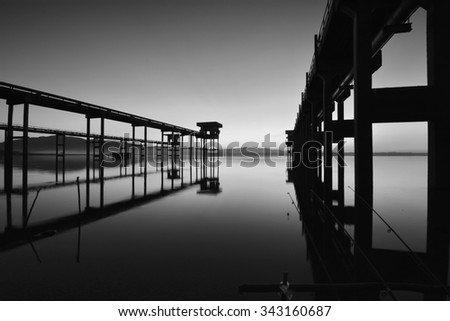 Bridge cement to pump water above the reservoir. - stock photo
