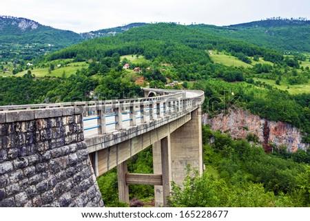 Bridge construction. Arc bridge in the mountains, North of Montenegro. One of the highest automobile bridges in Europe. - stock photo