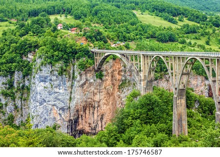 Bridge construction. Durdevica Tara arc bridge in the mountains, North of Montenegro. One of the highest automobile bridges in Europe. - stock photo