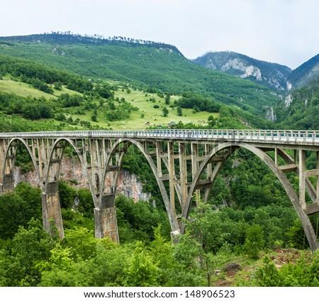 Bridge construction. Durdevica Tara concrete arc bridge in the mountains, North of Montenegro. One of the highest automobile bridges in Europe.   - stock photo