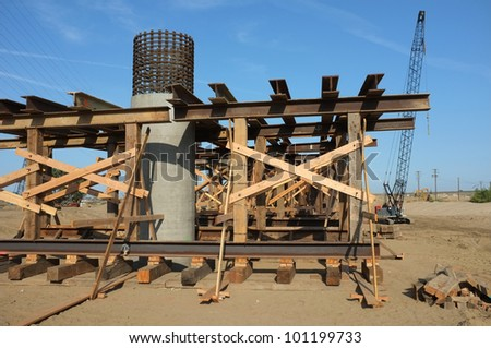 Bridge Construction Project: Temporary wood bracing and steel shoring support roadway beams before concrete is poured - stock photo